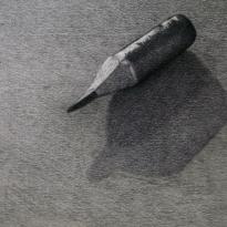 El final de un lápiz y la sombra proyectada
