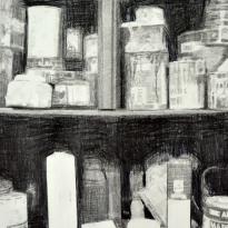 Rincón de un tapicero y latas
